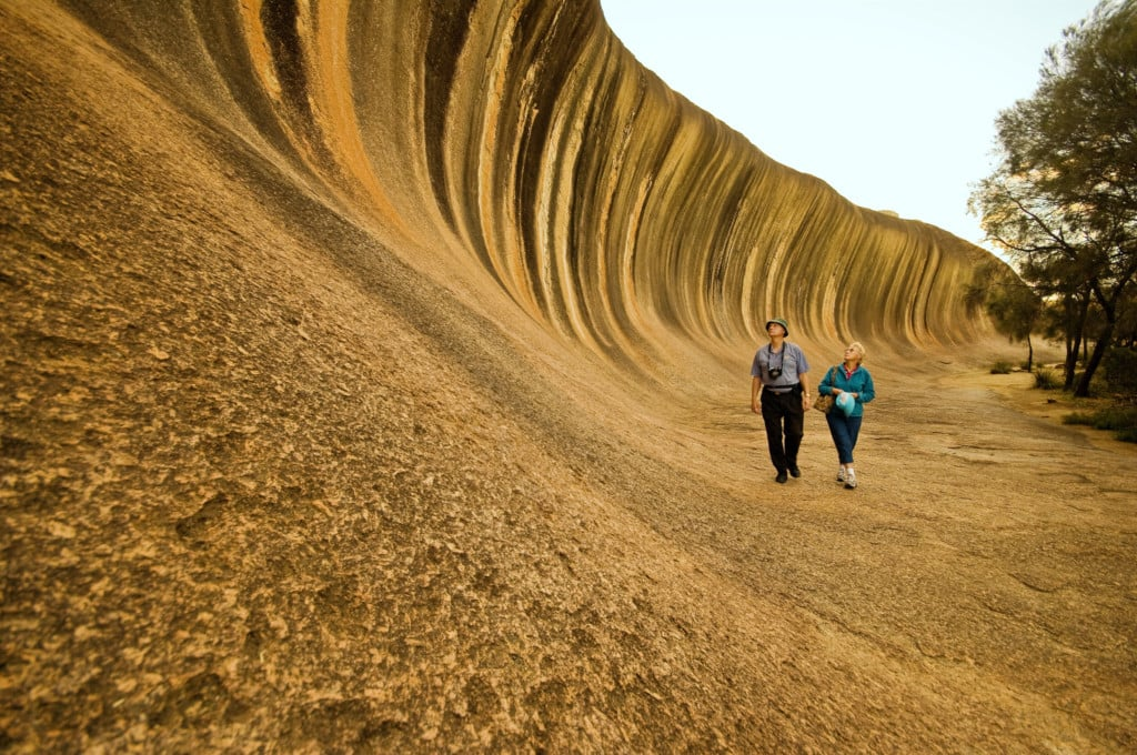 Couple viewing the unique Wave Rock, located near Hyden